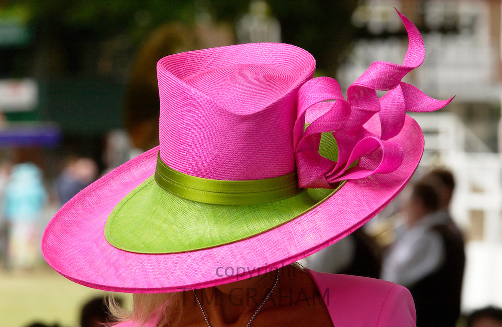 Race-goer wearing a huge hat in true Ascot fashion at Royal Ascot Races