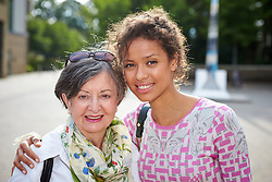 © Licensed to London News Pictures.  14/06/2014. WITNEY, UK. Actress Gugu Mbatha-Raw pictured with her mother Anne Raw in Witney. She returned to her home town of Witney in Oxfordshire for a special screening of the film Belle where she plays the lead role. Photo credit: Cliff Hide/LNP