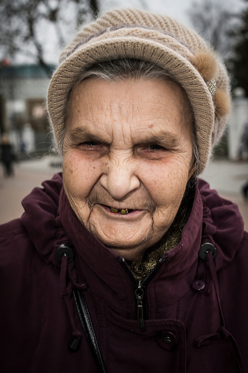 Galina, inhabitant of Daugavpils, Latvia pictured on the street of the city on 13.11.2014.  Latvian city Daugavpils is the largest city in the European Union inhabited by Russian-speaking population. <br /> <br /> The situation of ethnic Russians, who make up 40% of the population of the Baltic countries, is difficult. Lithuania, Latvia and Estonia after independence granted citizenship only to those who were (or whose ancestors were) the citizens of those countries before the Soviet occupation in 1944. <br /> Due to this only in Latvia about 500 000 Russians are without citizenship, since most of these do not want to learn Latvian, nor adapt to a new country with new rules.<br /> Today, there is a growing tendency to accept passports, offered by the Russian government. Some do it for financial reasons, because pensions in Russia are higher than those paid by the Baltic countries. Others take passports for political reasons. Everyone is talking &lsquo;we are left alone by European Union&rsquo;.<br /> <br /> by Wiktor Dabkowski