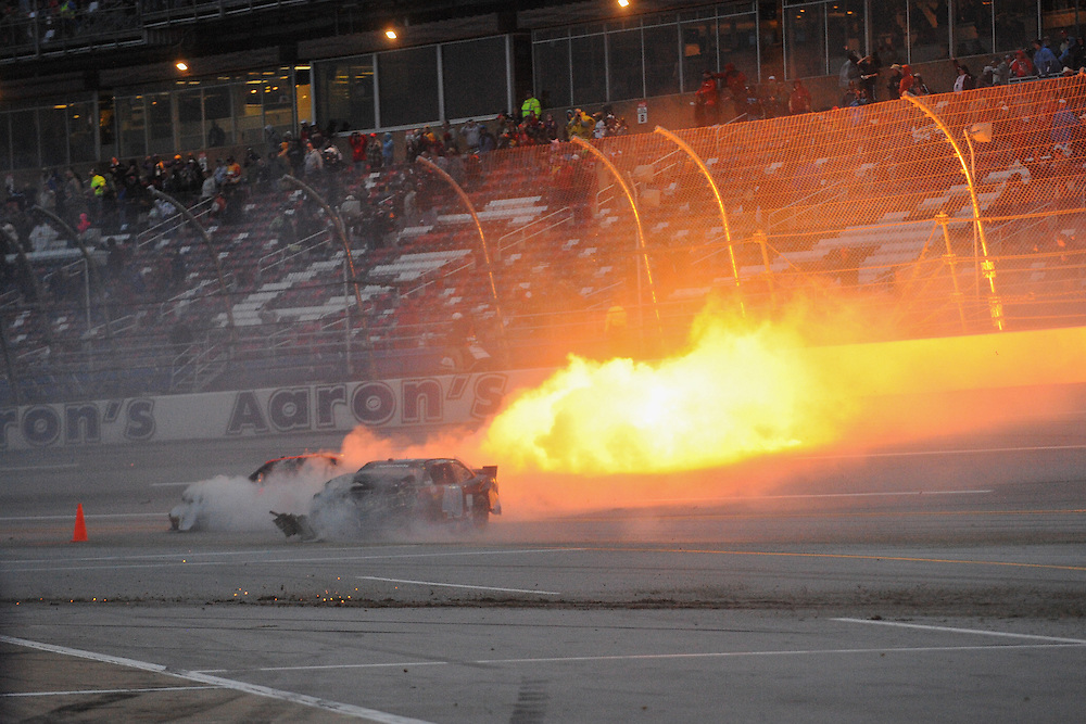 May 4, 2013; Talladega, AL, USA; NASCAR Nationwide Series driver Alex Bowman (99) car catches on fire after crashing on the final lap of the Aaron's 312 at Talladega Superspeedway. Regan Smith won the race. Mandatory Credit: Randy Sartin-USA TODAY Sports