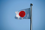 Japanese flag against a blue sky