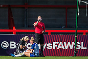 Lisa Walsh, Physiotherapist for Brighton & Hove Albion FC treating injured Danique Kerkdijk (Brighton) following the goal from Adelina Engman (Chelsea) during the FA Women's Super League match between Brighton and Hove Albion Women and Chelsea at The People's Pension Stadium, Crawley, England on 15 September 2019.
