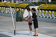 Japan, Hiroshima : HIROSHIMA, JAPAN - AUGUST 06: Two students ring a bell at the exacting time of the bombing 70 years ago