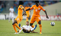 Faouzi Ghoulam (C) of Algeria is tackled by Gervinho (L) and Wilfried Bony of Ivory Coast during their AFCON 2015 Quarter Finals Match on February 1 2015 at Estadio de Malabo Equatorial Guinea. Photo/Mohammed Amin/www.pic-centre.com (Equatorial Guinea)