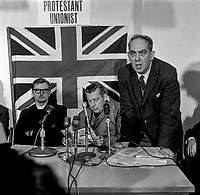 Rev William Beattie, Rev Ian Paisley and Major Ronald Bunting (left to right) at a Protestant Unionist Manifesto Press Conference.  Protestant Unionist was the forerunner of Paisley's Democratic Unionist Party. February 1969. 196902005241<br /> <br /> Copyright Image from Victor Patterson, 54 Dorchester Park, <br /> Belfast, UK, BT9 6RJ<br /> <br /> t1: +44 28 9066 1296 (from Rep of Ireland 048 9066 1296)<br /> t2: +44 28 9002 2446 (from Rep of Ireland 048 9002 2446)<br /> m: +44 7802 353836<br /> <br /> victorpatterson@me.com<br /> victorpattersonbelfast@gmail.com<br /> <br /> Please see my Terms and Conditions of Use at victorpatterson.com. It is IMPORTANT that you familiarise yourself with them.<br /> <br /> Images used on the Internet incur an additional cost and must be visibly watermarked i.e. ©Victor Patterson within the body of the image and copyright metadata must not be deleted. Images used on the Internet have a size restriction of 4kbs and are chargeable at rates available at victorpatterson.com.<br /> <br /> This image is available only for the use of the download recipient i.e. television station, newspaper, magazine, book publisher, etc, and must not be passed on to any third party. It is also downloaded on condition that each and every usage is notified within 7 days to victorpatterson@me.com<br /> <br /> The right of Victor Patterson (or the named photographer) to be identified as the author is asserted in accordance with The Copyright Designs And Patents Act (1988). All moral rights are asserted.