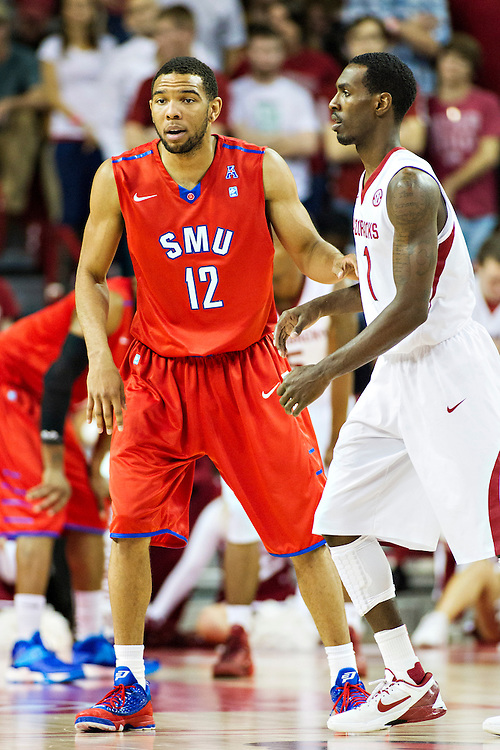 FAYETTEVILLE, AR - NOVEMBER 18:  Nick Russell #12 of the SMU Mustangs plays defense on Mardracus Wade #1 of the Arkansas Razorbacks at Bud Walton Arena on November 18, 2013 in Fayetteville, Arkansas.  The Razorbacks defeated the Mustangs 89-78.  (Photo by Wesley Hitt/Getty Images) *** Local Caption *** Nick Russell; Mardracus Wade