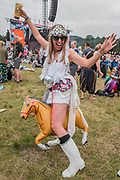 A bride to be brings her inflatable pony - The 2017 Latitude Festival, Henham Park. Suffolk 15 July 2017
