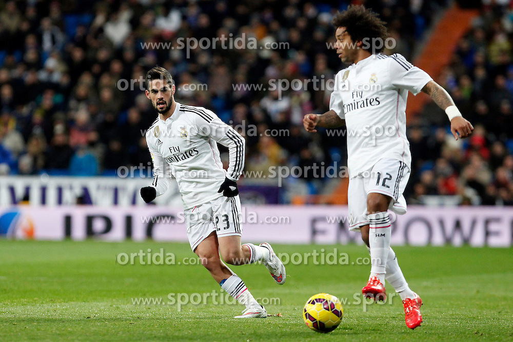 04.02.2015, Estadio Santiago Bernabeu, Madrid, ESP, Primera Division, Real Madrid vs FC Sevilla, 21. Runde, im Bild Isco and Marcelo of Real Madrid // during the Spanish Primera Division 21th round match between Real Madrid CF and FC Sevilla at the Estadio Santiago Bernabeu in Madrid, Spain on 2015/02/04. EXPA Pictures &copy; 2015, PhotoCredit: EXPA/ Alterphotos/ CARO MARIN<br /> <br /> *****ATTENTION - OUT of ESP, SUI*****