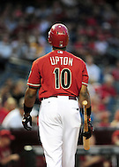Apr. 13 2011; Phoenix, AZ, USA; Arizona Diamondbacks outfielder Justin Upton (10) reacts on the field while playing against the St. Louis Cardinals at Chase Field. The Cardinals defeated the Diamondbacks 15 -5. Mandatory Credit: Jennifer Stewart-US PRESSWIRE