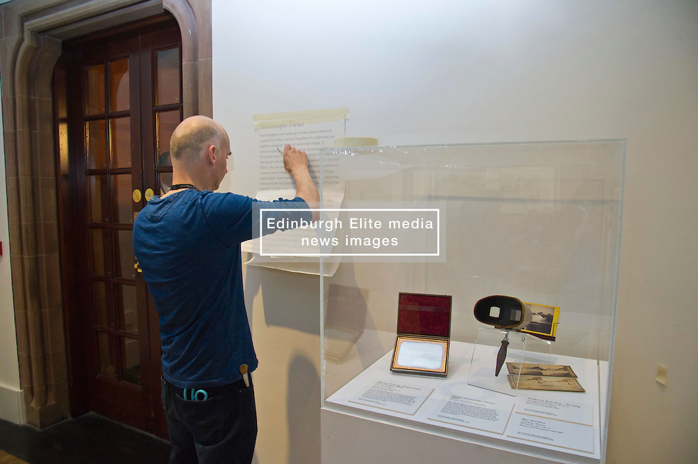 Pictured: Cavan Convery makes sure the words on steroscopic viewer is in perfect position.<br /> <br /> The View from Here exhibition at the Scottish National Portrait Gallery in Edinburgh brings together 70 key works charting the history of landscape and photography over 175 years. <br /> <br /> (c) Ger Harley | Edinburgh Elite media