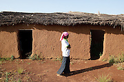 Abdulai Sadia stands outside the school where she used to teach children in the community of Kunayili, near Gushegu, Northern Ghana, on Wednesday November 2, 2011. Part of the roof collapsed a few months back, and she now teaches in another building lent by a community member.