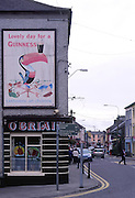 Lovely day for Guinness, advert on side of buildings, Skibbereen, County Cork, Ireland
