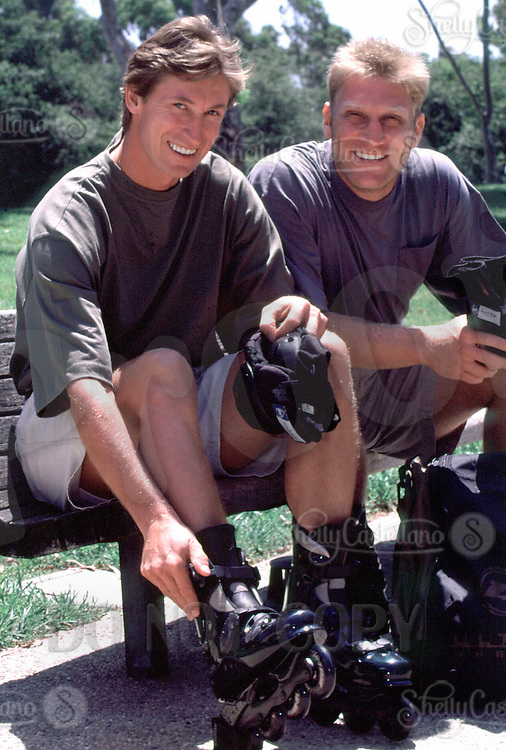 Jul 01, 1996; Los Angeles, CA, USA; NHL all time greatest ice hockey players WAYNE GRETZKY on the left and BRETT HULL on the right gear up with inline hockey skates to play Roller Hockey in street clothes for Ultra Wheels company.  Smile, Fun, Outdoors. .