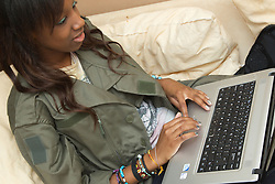 Teenage girl on laptop computer. (This photo has extra clearance covering Homelessness, Mental Health Issues, Bullying, Education and Exclusion, as well as the usual clearance for Fostering & Adoption and general Social Services contexts,)