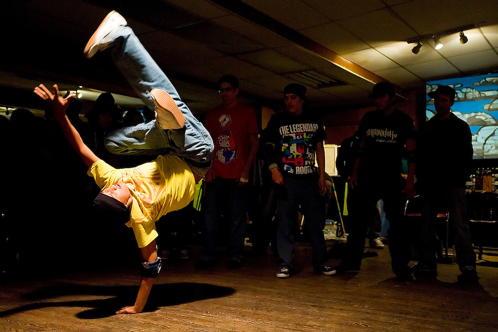 110808     Brian Leddy.Trumane Smith busts a move during a hip-hop show at Foundations of Freedom dance studio last Saturday during Arts Crawl. The event featured live DJs, painters and break dancers all performing at the same time.