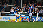 AFC Wimbledon midfielder Jake Reeves (8) blocks Rochdale FC defender Jim McNulty (4) during the EFL Sky Bet League 1 match between Rochdale and AFC Wimbledon at Spotland, Rochdale, England on 27 August 2016. Photo by Stuart Butcher.