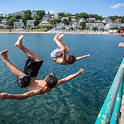"07/08/2012   SWAMPSCOTT, MA     Nick Scibelli (cq) 14 (left) and Christian Flynn (cq) 14, both of Swampscott, jump off the Swampscott Pier (cq).  They were attempting a simultaneous ""back-flip.""  (Aram Boghosian for The Boston Globe)"