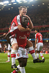 LONDON, ENGLAND - TUESDAY, SEPTEMBER 29th, 2009: Arsenal's Andrei Arshavin celebrates scoring his side's second goal with team-mate Emmanuel Eboue during the UEFA Champions League Group H match at the Emirates Stadium. (Photo by Chris Brunskill/Propaganda)