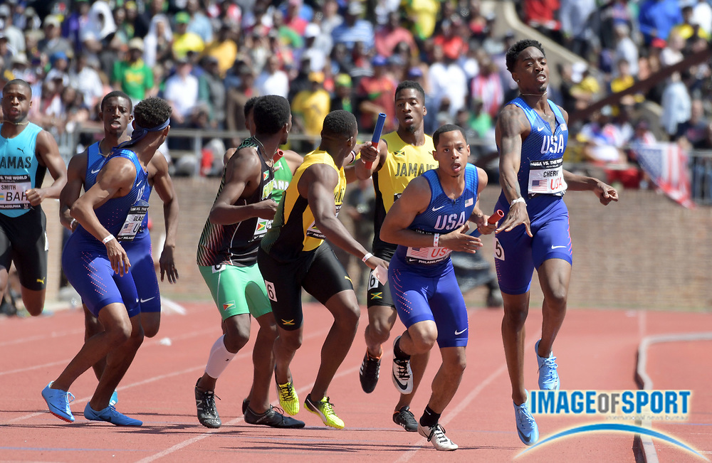 Apr 28, 2018; Philadelphia, PA, USA; Marcus Chambers takes the handoff from Michael Cherry on the third leg of the USA Red 4 x 400m relay that won the Championship of America race in 3:01.31 during the 124th Penn Relays at Franklin Field.