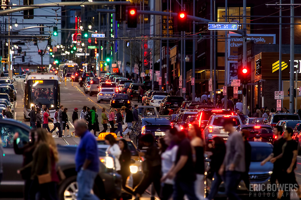 Photo of crowded city street; sidewalk and road traffic; Main Street, downtown Kansas City, Missouri.
