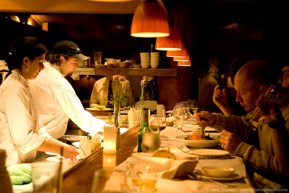Line cooks Shannon Thompson and Martin Pelletier at the Trattoria, a restaurant  at Whistler-Blackcomb ski resort in British Columbia, Canada.