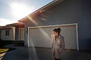 Heather Fredenberg stands in front of the house where her late husband Dan Fredenberg was shot in September 2012 in Kalispell, Montana.  (Rajah Bose for The New York Times)