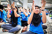 09 DECEMBER 2012 - BANGKOK, THAILAND:   Thai college students applaud durng an anti-corruption program at the Bangkok Art and Culture Centre (BACC). About 1,500 Thai university students from 90 universities across Thailand attended the rally. The latest Corruption Perceptions Index survey by Transparency International listed Thailand at number 88 out of 176 countries surveyed. The level of corruption in Thailand is perceived to be on the same par as Malawi, Swaziland and Zambia. Thailand's ranking slipped from 80 last year. A series of surveys show that Thais increasingly view corruption as acceptable. A recent ABAC (Assumption Business Administration College, the forerunner to Assumption University, one of the most respected private universities in Thailand) poll reported that a majority (63 per cent) of Thai people hold the view that corruption in government is acceptable as long as they also benefit from it. A majority of young people under 20 now hold the same attitude. International Anti-Corruption Day has been observed annually, on the 9th December, since the passage of the United Nations Convention Against Corruption on 31 October 2003.      PHOTO BY JACK KURTZ