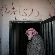 Mahmoud Abu Sbeih, 70, a palestinian refugee who escaped Syria with his family, enters the building of Cyber City, on december 21st 2013.