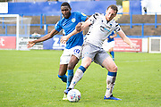 Macclesfield Town midfielder Emmanuel Osadebe andColchester United defender Tom Eastman in a challenge for the ball during the EFL Sky Bet League 2 match between Macclesfield Town and Colchester United at Moss Rose, Macclesfield, United Kingdom on 28 September 2019.