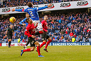 Rangers James Tavernier (C) jumps underneath the ball in the Kilmarnock penalty box during the Ladbrokes Scottish Premiership match between Rangers and Kilmarnock at Ibrox, Glasgow, Scotland on 16 March 2019.