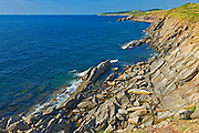 Appalachain Mountains chain and rocky shoreline along the Gulf of St. Lawrence. Cape Breton Island. Cabot Trail. <br />