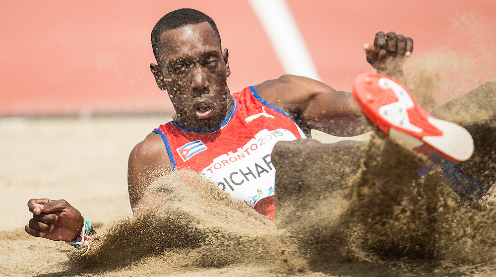 Pedro Pablo Pichardo of Cuba competes in the men's triple jump at CIBC Athletics Stadium at the 2015 Pan American Games in Toronto, Canada, July 24,  2015.  AFP PHOTO/GEOFF ROBINS