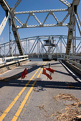 08 Sept 2005. New Orleans, Louisiana. Hurricane Katrina aftermath. <br /> East New Orleans, where the tidal surge washed over the land and devastated homes and property The Chef Menteur highway ends at the first steel bridge which has been turned to permit the flow of water to pass freely.<br /> Photo; ©Charlie Varley/varleypix.com
