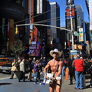 The Naked Cowboy performing in Time Square, New York. Times Square is the major commercial intersection in Midtown Manhattan, New York City. Time Square, New York, USA. 27th April 2012. Photo Tim Clayton