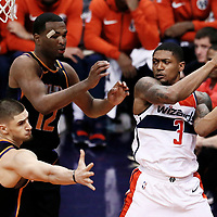 07 December 2017: Washington Wizards guard Bradley Beal (3) passes the ball around Phoenix Suns forward TJ Warren (12) and Phoenix Suns center Alex Len (21) during the Washington Wizards 109-99 victory over the Phoenix Suns, at the Talking Stick Resort Arena, Phoenix, Arizona, USA.