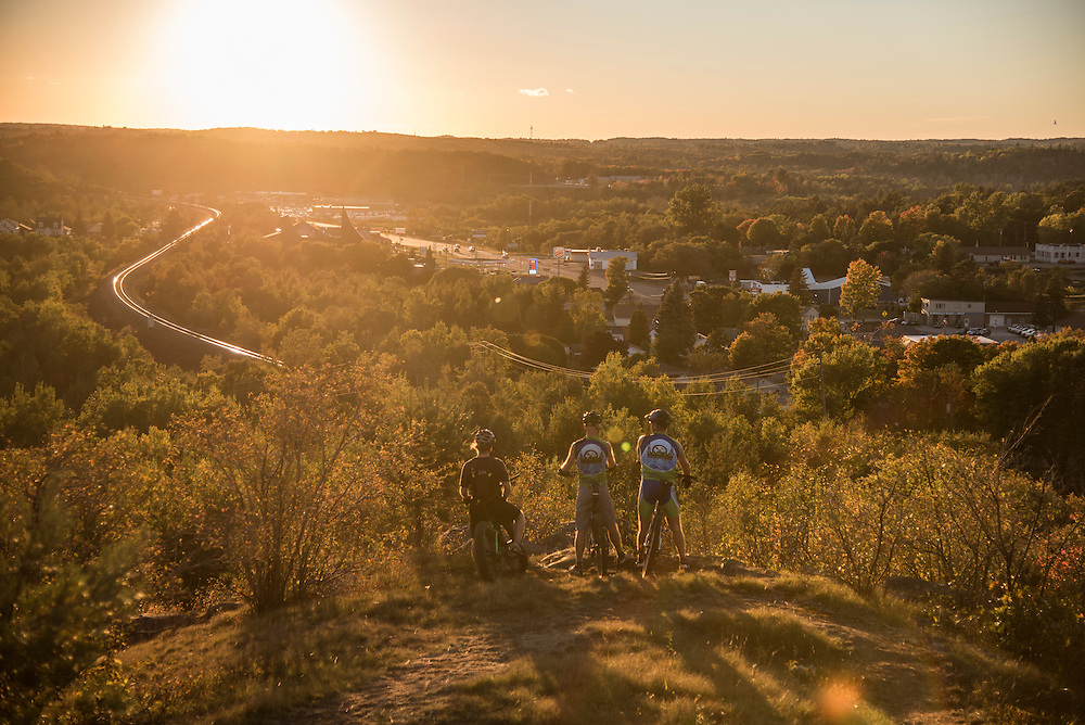 Mountain bikers enjoy a sunset from an overlook on the Range Area Mountain Bike Association trails in Ishpeming, Michigan.