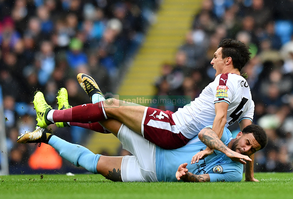 Manchester City's Kyle Walker (right) challenges Burnley's Jack Cork