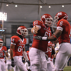 Dec 19, 2009; St. Petersburg, Fla., USA; Rutgers wide receiver Mohamed Sanu (6) celebrates his touchdown with Rutgers center Ryan Blaszczyk (61) during NCAA Football action in Rutgers' 45-24 victory over Central Florida in the St. Petersburg Bowl at Tropicana Field.