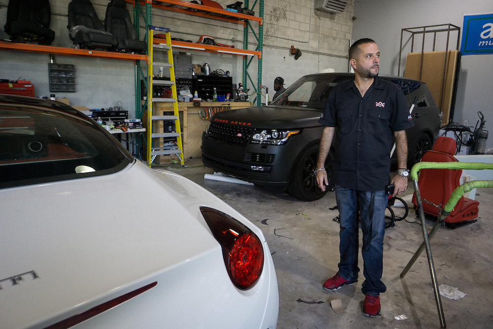 DORAL, FLORIDA, DECEMBER 11, 2015<br /> Alex Vega, owner of The Auto Firm, a South Florida car customizing and restoring shop which has a vast clientele of professional athletes and entertainers. His office walls are full of mementos given to him and signed by his clients.<br /> (Photo by Angel Valentin/Freelance)