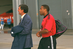 LIVERPOOL, ENGLAND - Monday, September 11, 1995: Liverpool's captain John Barnes and Trevor Brooking board the Aeroflot Tupolev Tu-154 RA-85715 aircraft at Liverpool Airport before the squad travel to Russia ahead of the UEFA Cup 1st Round 1st Leg match against FC Alania Spartak Vladikavkaz. (Photo by David Rawcliffe/Propaganda)