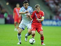 Fotball<br /> 16.06.2012<br /> EM 2012<br /> Russland v Hellas<br /> Foto: Witters/Digitalsport<br /> NORWAY ONLY<br /> <br /> v.l. Kostas Katsouranis, Andrey Arshavin (Andrej Arschawin, Russland)<br /> Fussball EURO 2012, Vorrunde, Gruppe A, Griechenland - Russland
