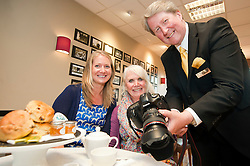 Susie Corbishley (left) and Cheryl Weston with Royal Photographer Ian Pelham-Turner in the Debenhams restaurant Harrogate on Thursday Afternoon..7 June 2012.Image © Paul David Drabble