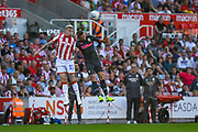 Leeds United defender Stuart Dallas (15) and Stoke City midfielder James McClean (11) during the EFL Sky Bet Championship match between Stoke City and Leeds United at the Bet365 Stadium, Stoke-on-Trent, England on 24 August 2019.