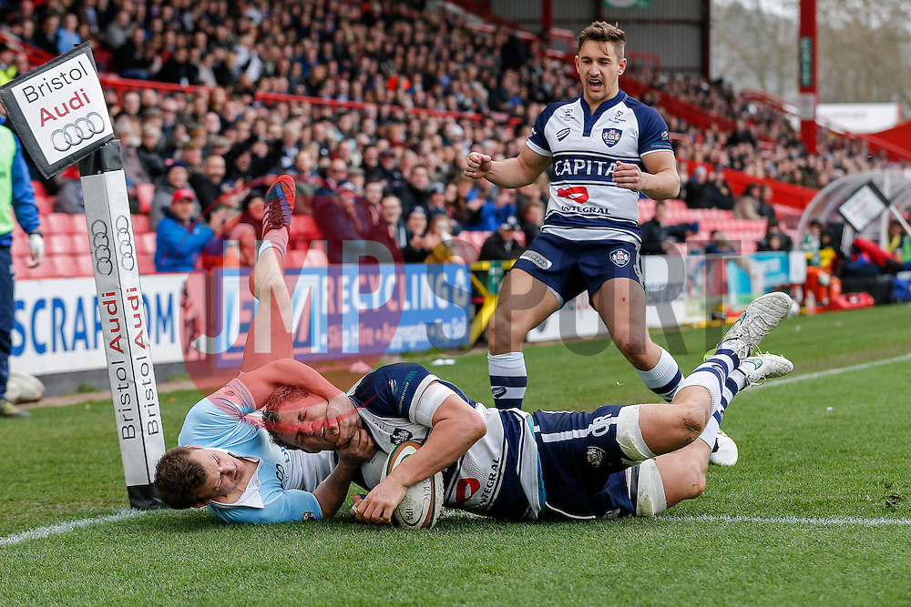 Bristol Rugby Flanker Olly Robinson scores a try as Bedford Blues Scrum-Half Darryl Veenendaal challenges -  Photo mandatory by-line: Rogan Thomson/JMP - 07966 386802 - 29/03/2015 - SPORT - Rugby Union - Bristol, England - Ashton Gate Stadium - Bristol Rugby v Bedford Blues - Greene King IPA Championship.