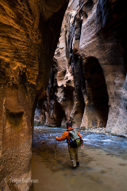 A person hikes in The Narrows canyon that is carved by the Virgin River in Zion National Park, near Springdale, Utah