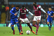 Cardiff City midfielder Nathaniel Mendez-Laing (19) battles for possession  with Aston Villa defender (on loan from Manchester United) Axel Tuanzebe (28)during the EFL Sky Bet Championship match between Aston Villa and Cardiff City at Villa Park, Birmingham, England on 10 April 2018. Picture by Dennis Goodwin.