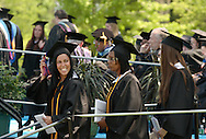 Middletown, NY - A graduate, at left, smiles after receiving her diploma during the 58th commencement at Orange County Community College on May 17, 2008.