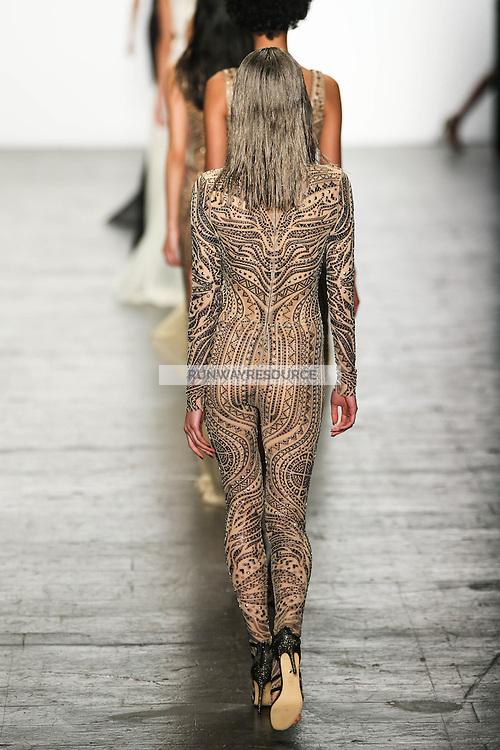 Marga Esquivel (Women) walks the runway wearing Tadashi Shoji Fall 2016 during New York Fashion Week on February 12, 2016