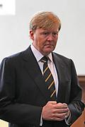 Prins Willem-Alexander bij de 70e herdenking bij van de slag in de Javazee in de Kloosterkerk , Den Haag.<br /> <br /> Prince Willem-Alexander at the 70th commemoration of the battle in the Java Sea in the Monastery Church, The Hague.<br /> <br /> Op de foto/ On the photo:  Prins Willem Alexander