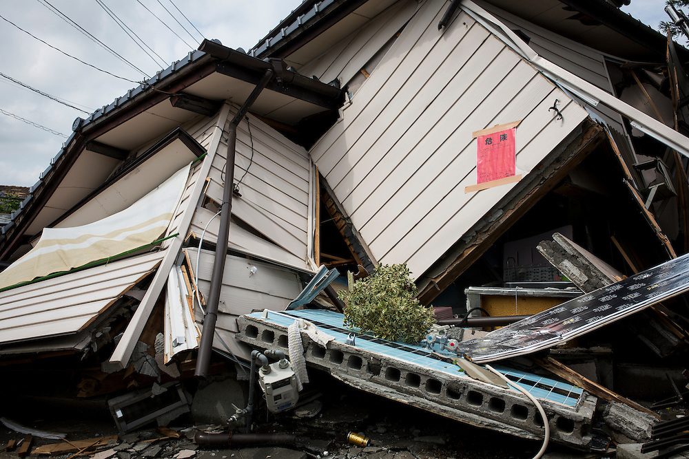 KUMAMOTO, JAPAN - APRIL 22:  An 'unsafe' notice is stuck to the wreckage property after it has been check by Japan's Emergency Risk Discriminators on April 22, 2016 in Mashiki town, Kumamoto, Japan. To date 48 people are confirmed dead and more than 80,000 people have evacuated after an 6.5 earthquake on Thursday night and a stronger 7.3 quake on Saturday morning struck the Kyushu Island in western Japan.<br /> <br /> Photo: Richard Atrero de Guzman